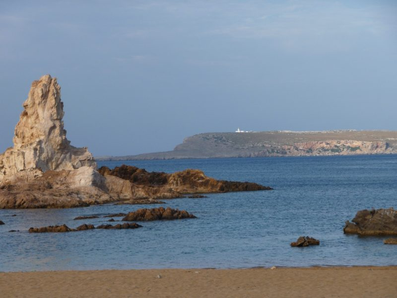 View of the Cavalleria lighthouse from Pregonda (white background)